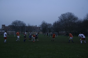 Teams battle for possession in the middle of the pitch.